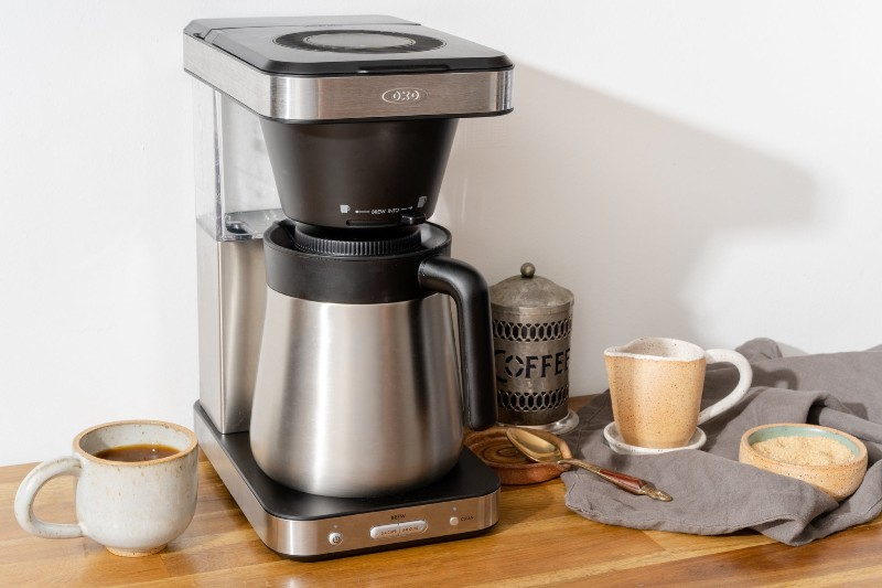 What are the benefits of having a coffee brewing machine at home?